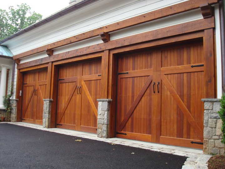 3 single car wooden garage door semper fidelis garage doors for Best wood for garage doors